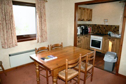 The dining room in Struan Cottage, Lochcarron, has a dining table and seating for 4 people.