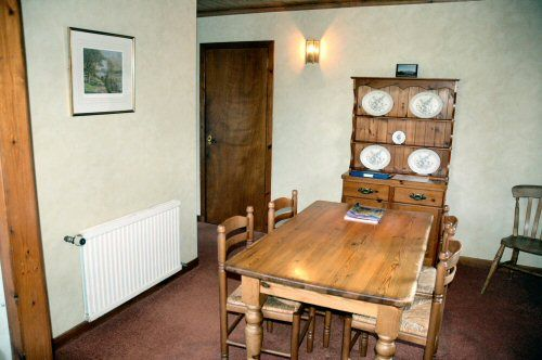 The dining room in Struan has a dining table and seating for 4 people. It is immediately adjacent to the kitchen.